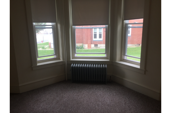 147 E Main St, 1st Floor 3 bedroom apartment with high ceilings, front porch and tons of closets.  Lots of natural light (Photo 4)