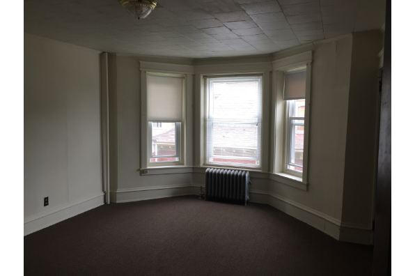 149 East Main Street, 2nd Floor 3 Bedroom and 1 Bath with high ceilings and tons of closets.  Every bedroom has a closet and each bedroom has a dead bolt on the bedroom door (Photo 5)